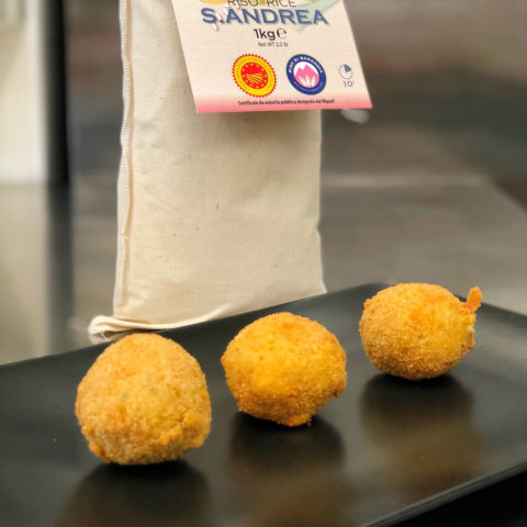Arancini (Sant'Andrea Baraggia rice PDO croquettes) with shrimps, pink pepper and orange zest.